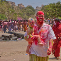 Drew and Cole, apparently in the midst of a festival of color. My guess is in India, somewhere.